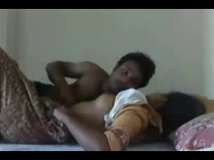 Couple On Bed Grabbing & Kissing Each Other